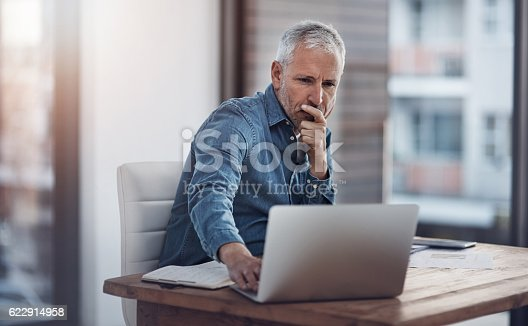 istock Working through ways to better manage his business 622914958