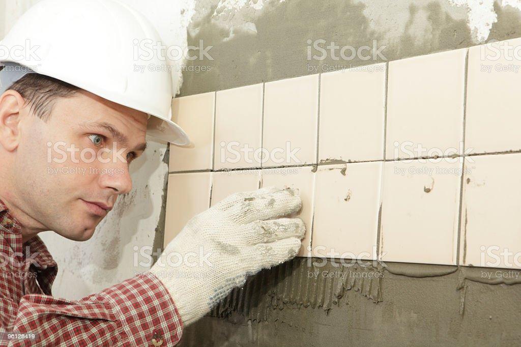 Working tiler royalty-free stock photo
