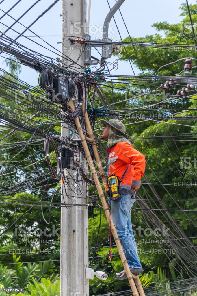 Working to install electric line stock photo