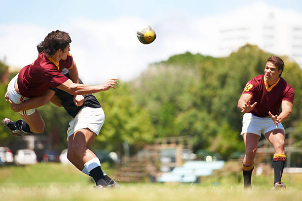 working together for stronger unity - rugby stock photos and pictures