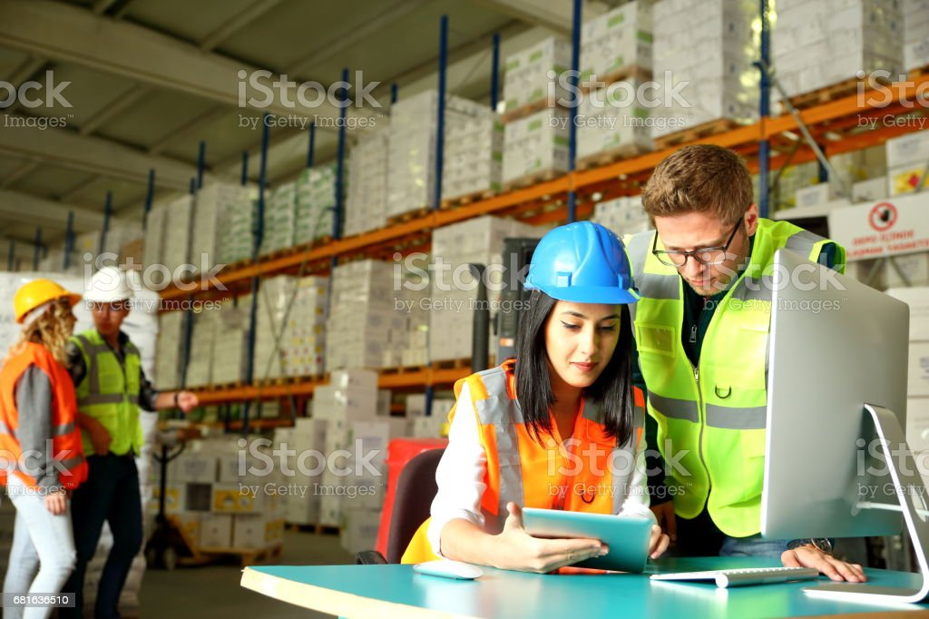 Working together in a warehouse stock photo