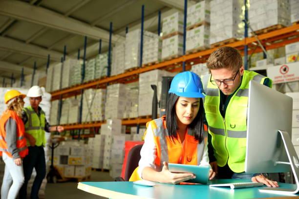 working together in a warehouse - checklist stock photos and pictures