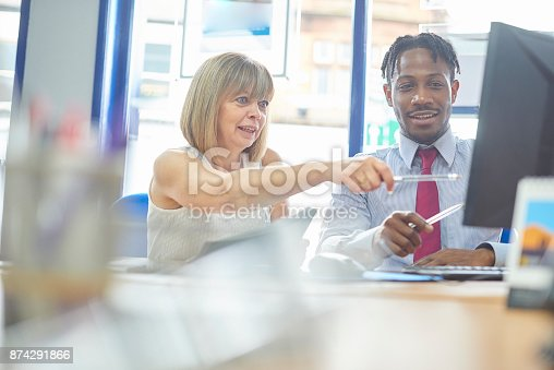 istock Working together in the office 874291866