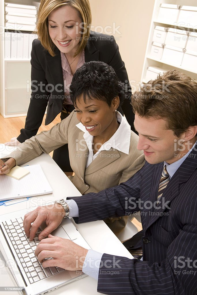 Working Together on Laptop royalty-free stock photo