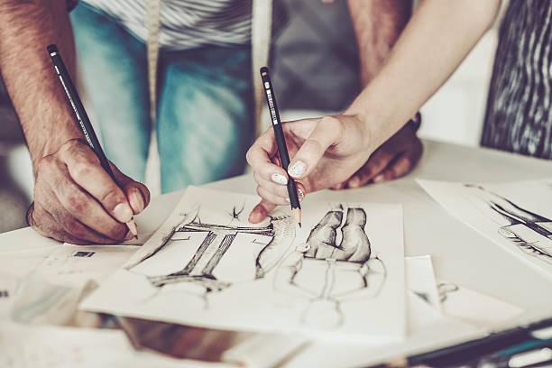lavorare insieme  - tailor working foto e immagini stock