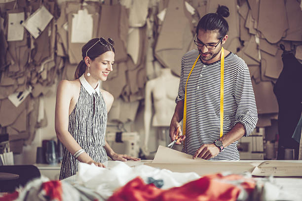Working together Working together fashion designer stock pictures, royalty-free photos & images