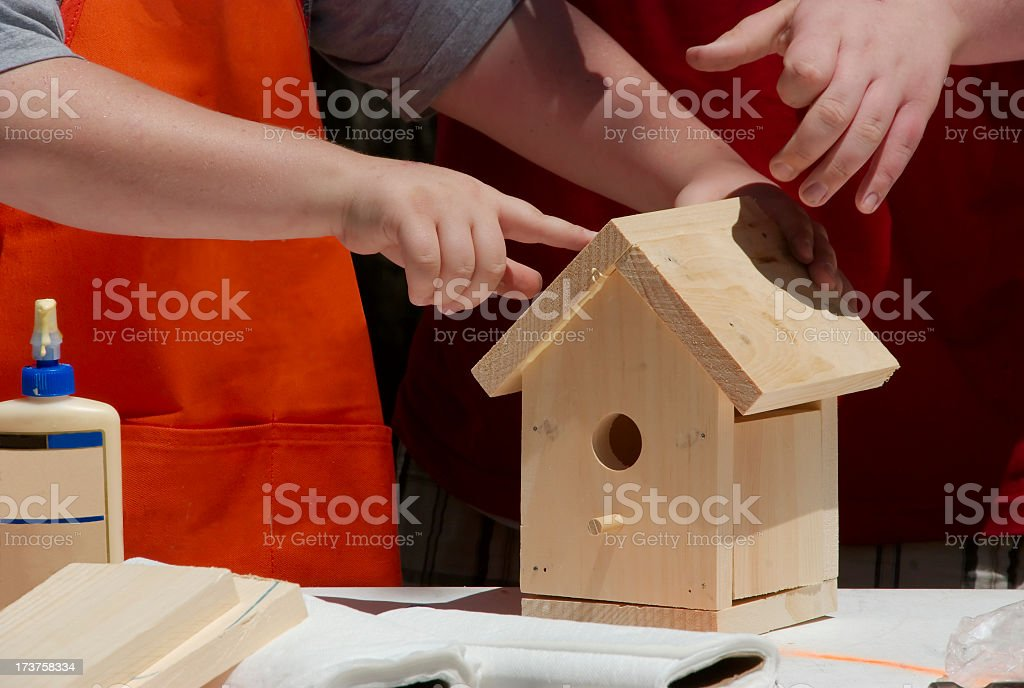 Working together to build a bird house stock photo