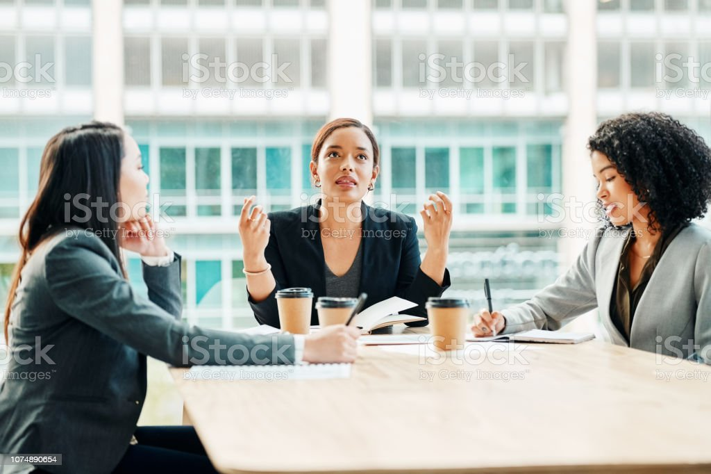 Working together to come up with more ideas stock photo