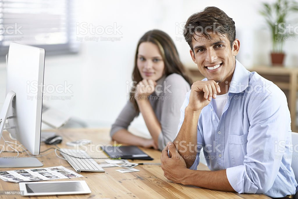 Working together to edit their portfolio royalty-free stock photo
