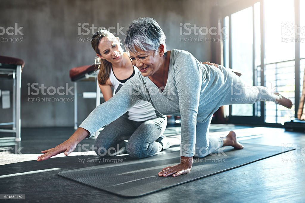Working together to improve muscle strength and tone stock photo