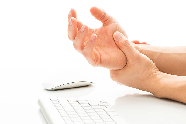 working too much - suffering from a carpal tunnel syndrome - pols stockfoto's en -beelden