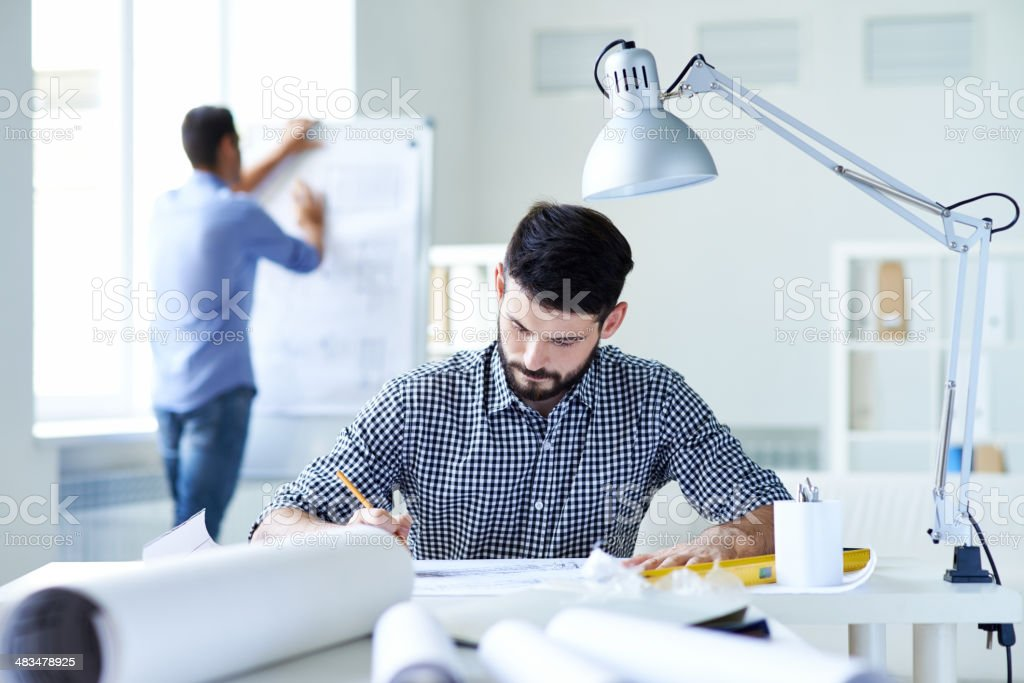 Working up to his ears royalty-free stock photo