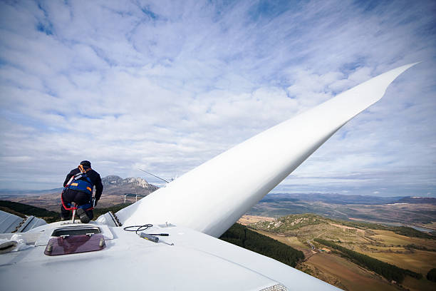 Working upon wind turbine stock photo