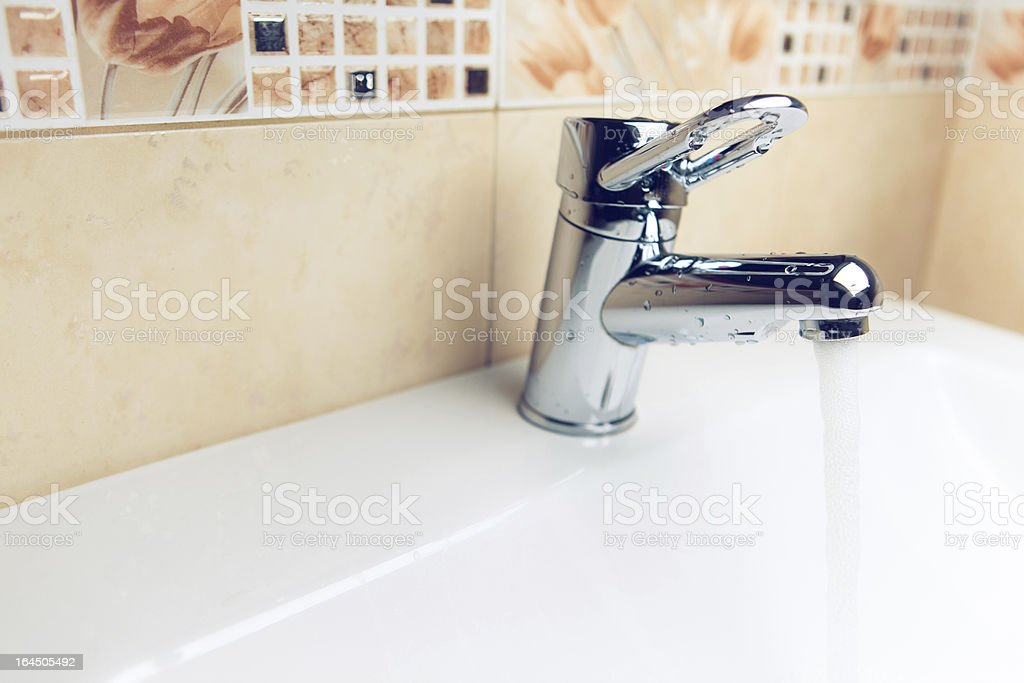 working water tap royalty-free stock photo
