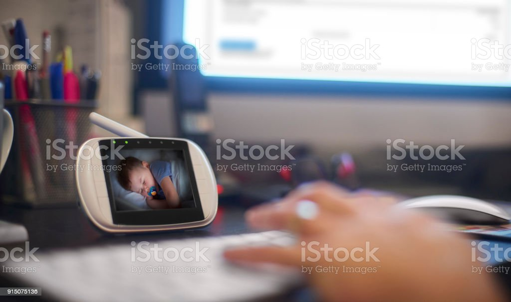 Working while the toddler sleeps stock photo