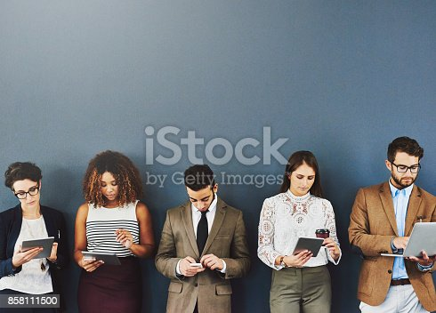 858111468 istock photo Working while they wait 858111500