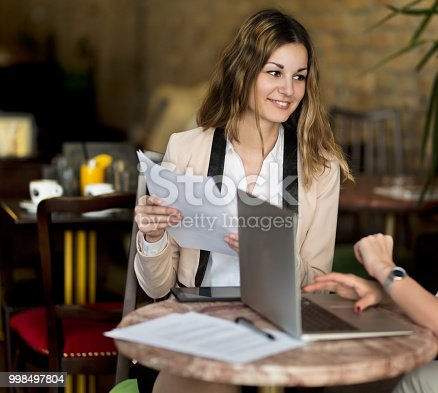 1031394390istockphoto Working with a big smile 998497804