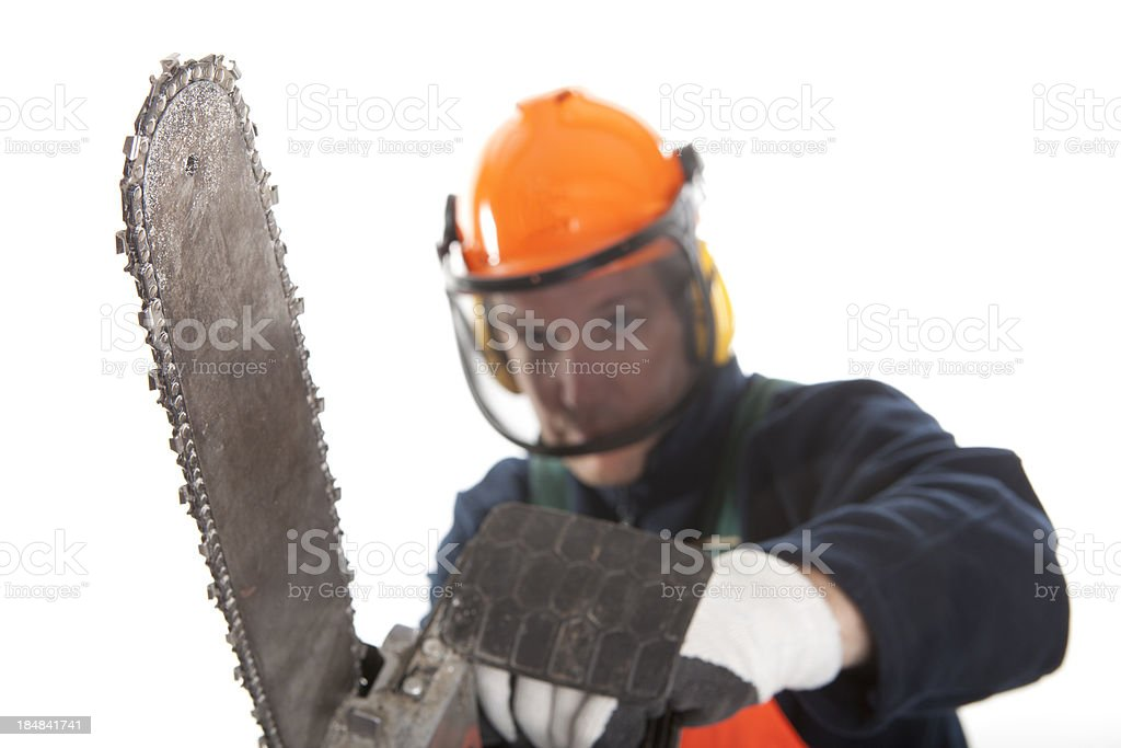 Working with a chainsaw royalty-free stock photo