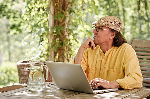 Working with a laptop at home stock photo