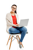 Beautiful and happy woman working with a laptop, isolated over white background