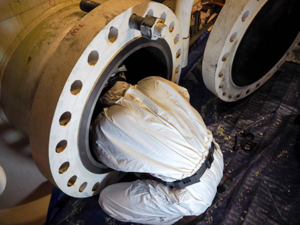 Working with confined space Working with confined space confined space stock pictures, royalty-free photos & images