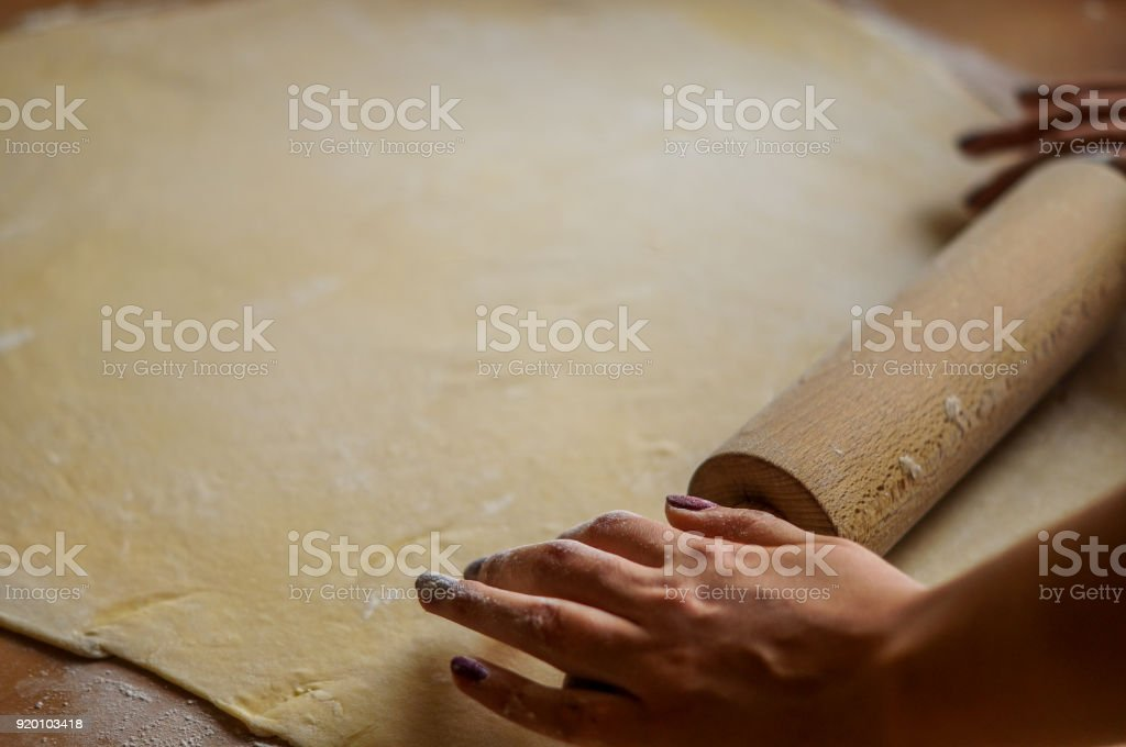 Working with dough on the wooden table stock photo