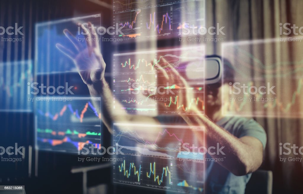 Working with futuristic charts in Virtual Reality Glasses foto de stock royalty-free