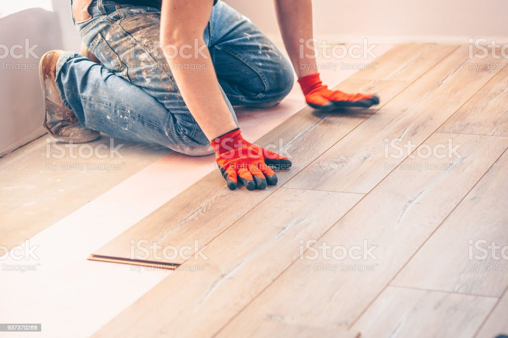 Working With Hands Installs A Laminate Board Professional Flooring
