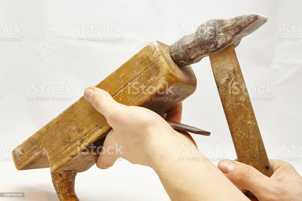 working with jack-plane and hammer stock photo