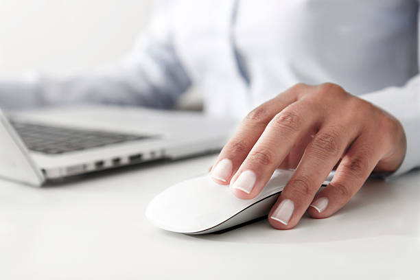 working with laptop - computer mouse stock photos and pictures