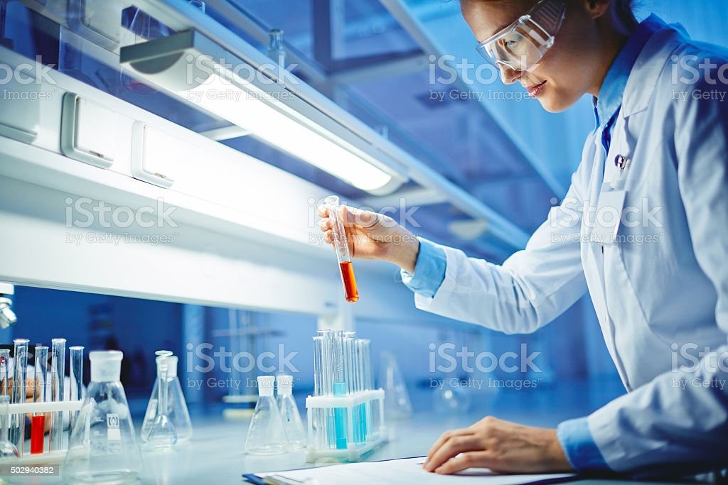 Modern clinician studying new liquids in laboratory
