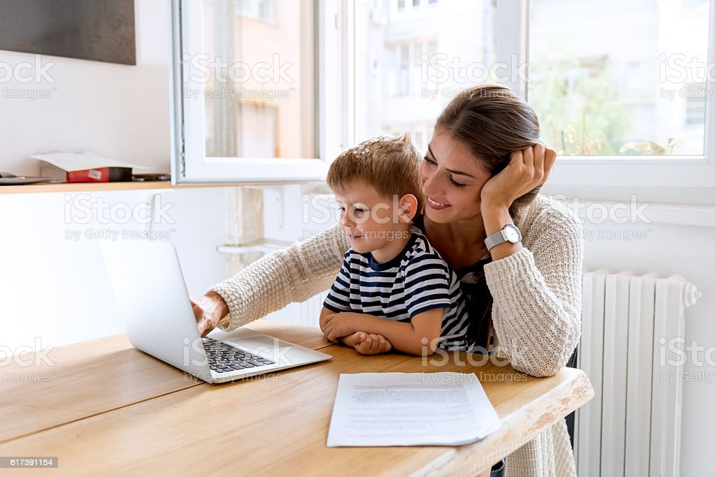Working with mommy stock photo