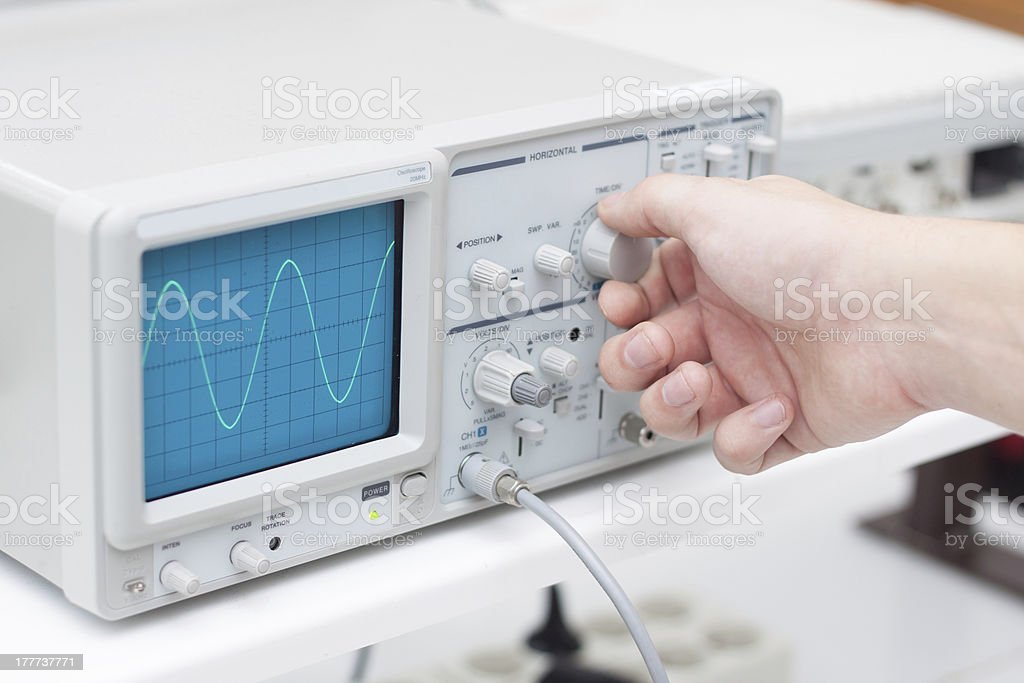 Working with oscilloscope in laboratory royalty-free stock photo