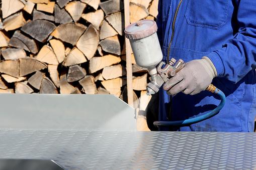 istock Working with paint spray gun 623430974