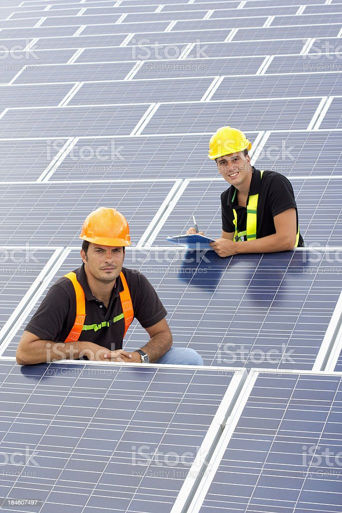 Working with photovoltaic panels royalty-free stock photo
