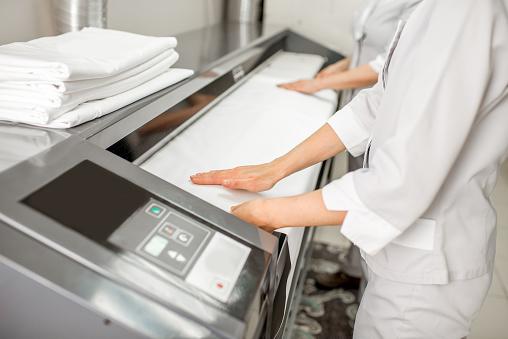 Working with professional ironing machine
