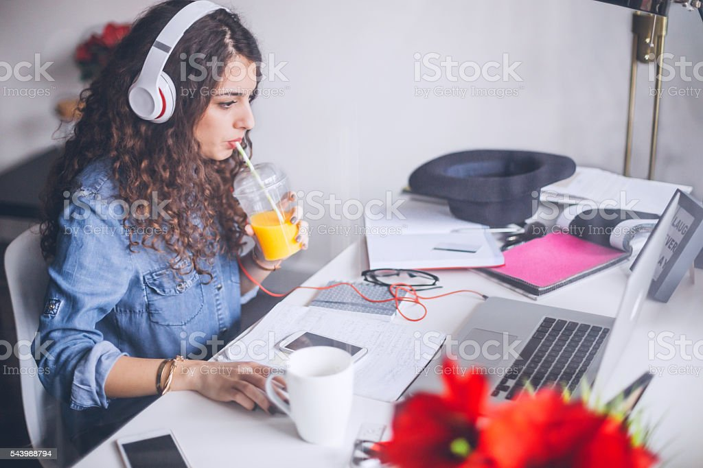 Working with relaxing music on headphones stock photo