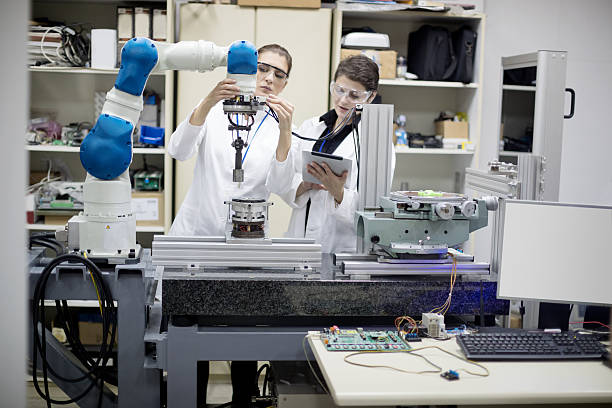 Working with robotic arm stock photo