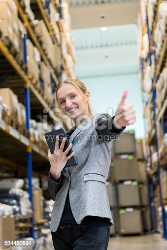 915900234istockphoto Working with success in warehouse 534480594