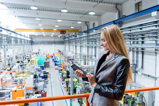 Working with tablet in futuristic factory stock photo