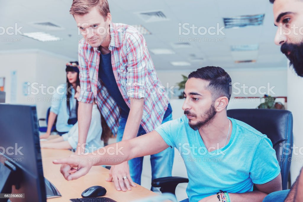 Working with team of young design enthusiasts and computer professionals stock photo