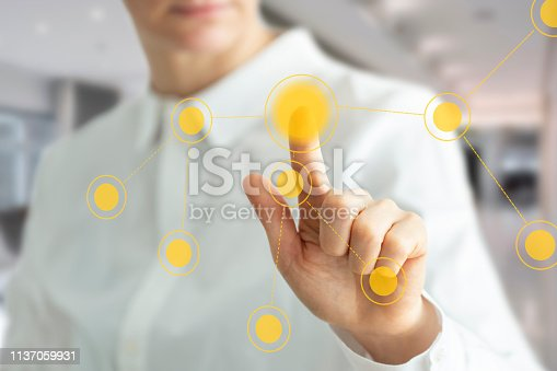515789546istockphoto Working with touch screen at the office 1137059931