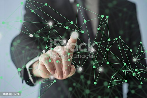 515789546istockphoto Working with touch screen 1033101786