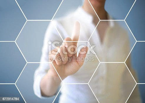 515789546istockphoto Working with touch screen 672314784