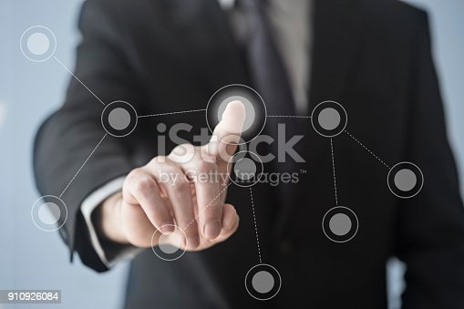 515789546istockphoto Working with touch screen 910926084