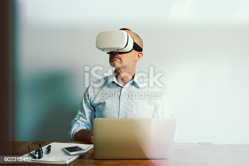 istock Working with Virtual Reality Headset Laptop and Smartphone 602318452