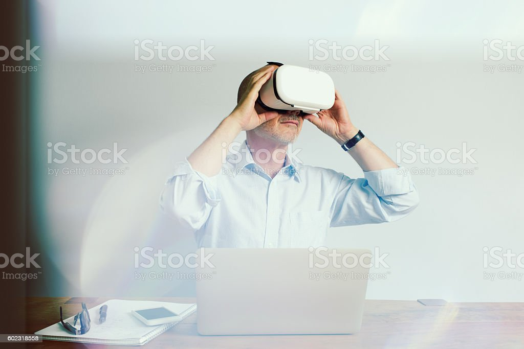 Working with Virtual Reality Headset Laptop and Smartphone stock photo