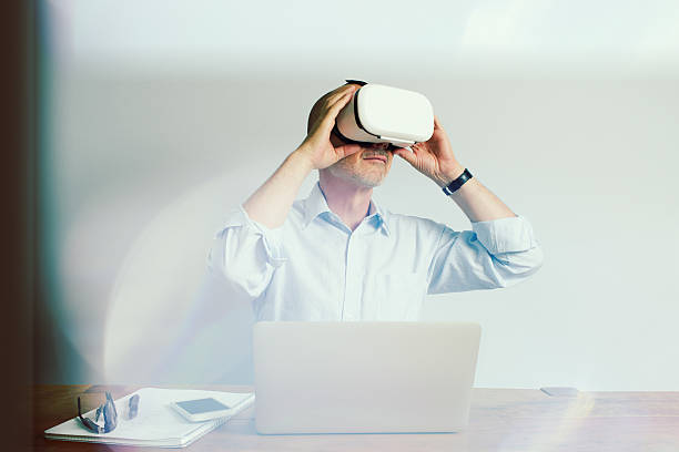 Working with Virtual Reality Headset Laptop and Smartphone - Photo