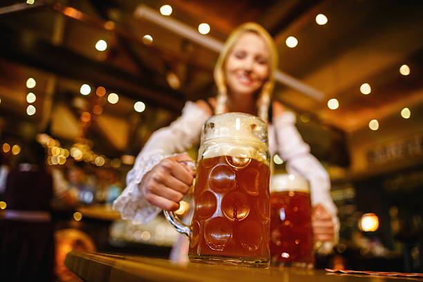 working woman - oktoberfest stock photos and pictures