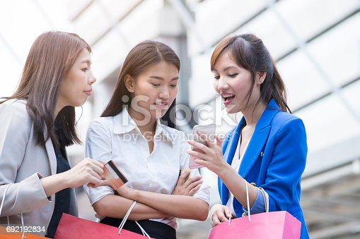 Working women chatting about online shopping